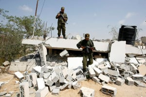 Hamas inspect their headquarters destroyed by the IDF during Operation Protective Edge. (Photo: Abed Rahim Khatib/Flash90)