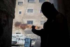 An Arab terrorist shoots firecrackers at an Israeli target. (Photo: Hadas Parush/ Flash90)