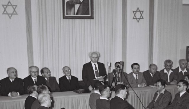 David Ben Gurion reading the declaration of the Independence of Israel in the Tel Aviv Museum, 1948. Photo: State of Israel National Photo Collection.