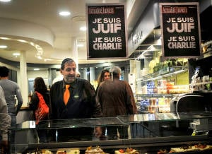 "Signs reading ""I am Charlie"" and ""I am Jewish"" at a store in Paris. (Photo: Serge Attal/Flash90)"