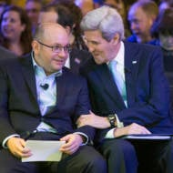 Freed Washington Post reporter Jason Rezaian, left, speaks with Secretary of State John Kerry. (AP/J. Scott Applewhite)