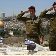 IDF soldiers salute their fallen comrades. (Nati Shohat /Flash90)