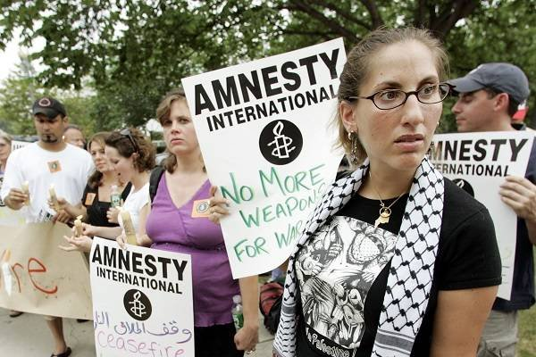 An Amnesty International demonstration. (AP Photo/Manuel Balce Ceneta)