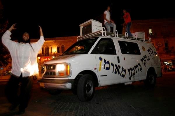 Dancing on a van roof in Jerusalem. (Miriam Alster/Flash90)