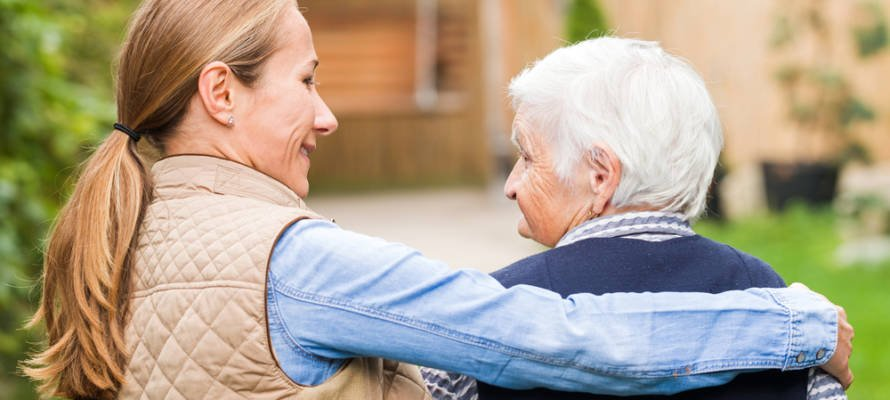 elderly person with caregiver