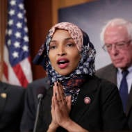 Freshman Rep. Ilhan Omar, D-Minn., center, joins Rep. Peter Welch, D-Vt., left, and Sen. Bernie Sanders, I-Vt. (AP Photo/J. Scott Applewhite)