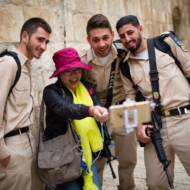 A tourist seen taking selfies with soldiers in Jerusalem's Old City. (Corinna Kern/FLASH90)