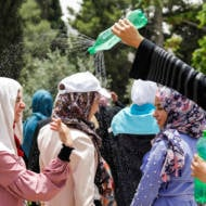 Muslim women cool off during Ramadan. (Sliman Khader/Flash90)