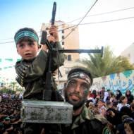 A Palestinian child holding a machine gun at a Hamas rally in the Gaza Strip